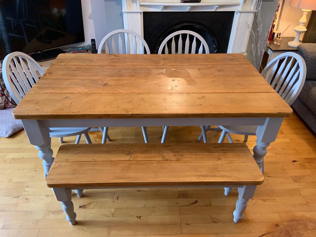White dining room table with bench made from reclaimed wood