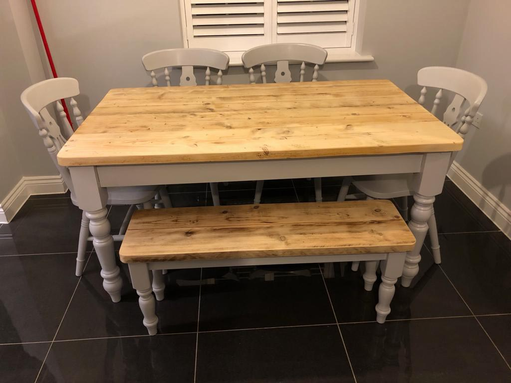 Grey dining table made from reclaimed wood with sanded top