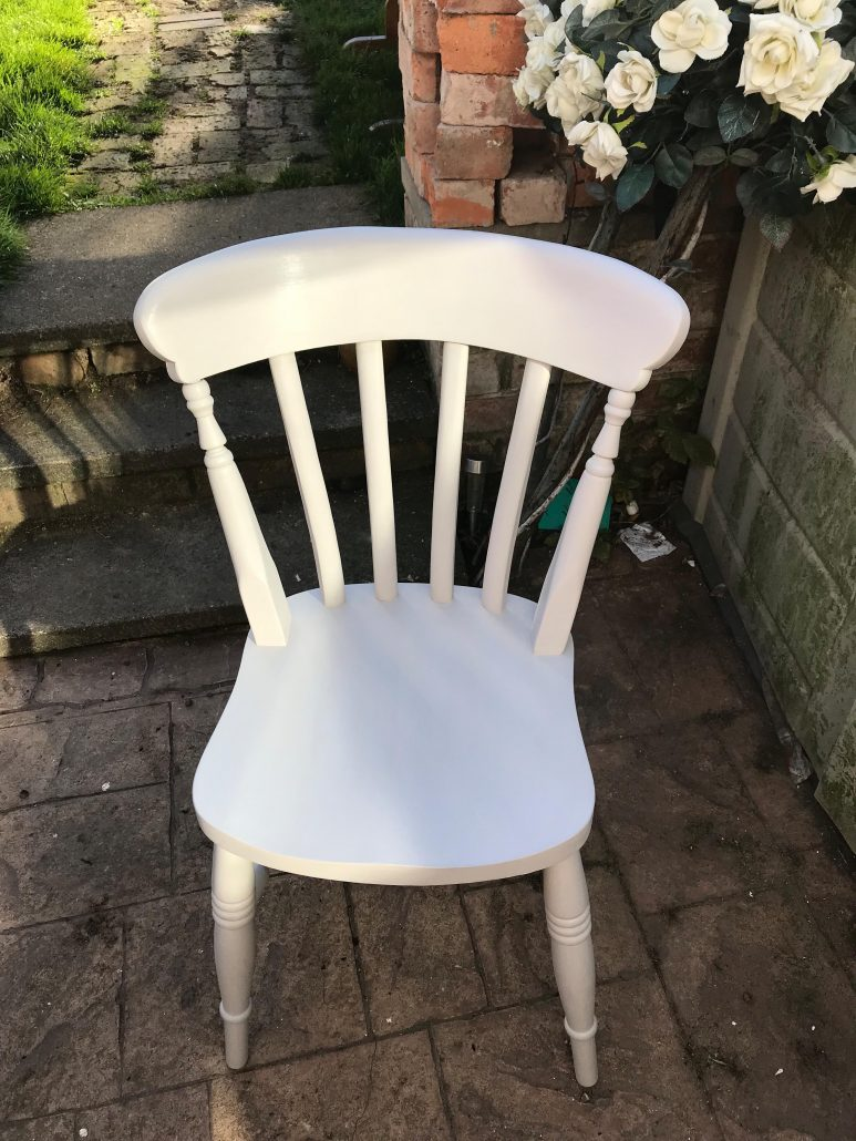 Restored dining room chair sanded and painted in white