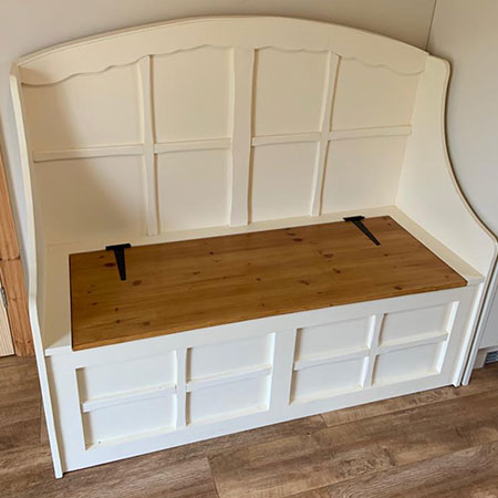 Refurbished wooden daybeds and chests